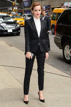 Actress Emma Watson arrives at the Late Show With David Letterman on March 25, 2014 wearing a Saint Laurent suit.