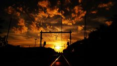 #backlit #clouds #dark #dawn #dusk #industry #locomotive #railway #silhouette #station #sun #sunset #track #train station #train tracks #transportation system #travel #vehicle #royalty free images
