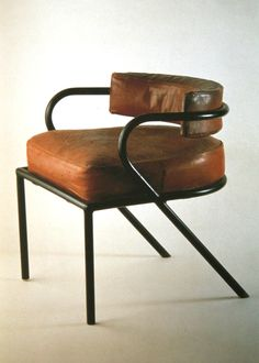 Rene Herbst — armchair is made mostly off metal and steel, (mostly its hole frame).