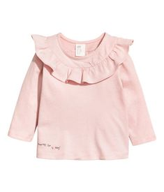 Powder Pink Long Sleeved Top In Soft Cotton Jersey Flounce And Concealed Snap Fastener At Top And A Small Printed Little Girl Fashion Tops Baby Girl Fashion