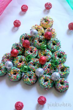 A Donut Tree Dessert is the perfect thing to serve at any holiday party. Just watch it disappear!