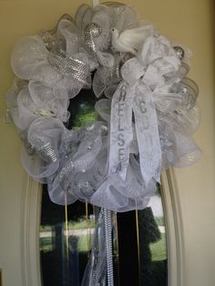 Wedding wreath made from deco mesh and ribbon.  Includes bride and groom's name on flowing ribbon.