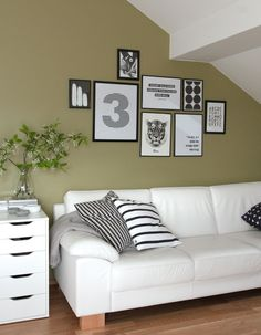 Nordic Living Room With Black And White Prints And Cushions, White Leather  Couch, IKEA