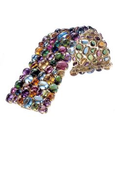 Bulgari bracelet in 18kt yellow gold with multi-colored gemstones