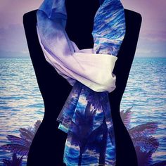 Be like the beautiful palm trees, swaying in a dreamy seascape. Call out your inner mermaid, delight in soft sunset pinks & ocean blues that soothe your senses. Get the paradise vibe, wrapped in a gorgeous scarf that floats on the warm breezes. Look your best no matter where your wanderlust takes you. Always beautiful, this scarf is your go-to accessory for lush comfort & chic style - while relaxing poolside, shopping for those perfect macarons or for a beautifully memorable night out under…