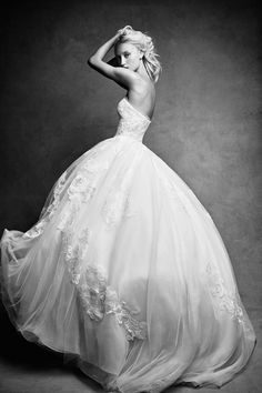 This white Vera Wang strapless wedding dress is so romantic! Love all the floral detailing on this ball gown wedding dress by #DavidsBridal