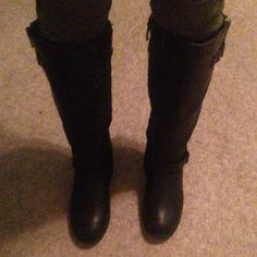 Black riding boots These are of either leather or pleather material. The top part of the boot is stretchable. There's heel at the bottom of the boot that is about inch or an inch in a half. These have a strap on the top and another on the bottom that goes across. I only wore these about once or twice and they're in excellent condition! Top moda Shoes Winter & Rain Boots