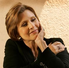 """Carrie Fisher, the actress/writer and daughter of Debbie Reynolds and Eddie Fisher who came to fame 40 years ago as Princess Leia in """"Star Wars,"""" died on this date a year ago at the age of 60. Before her death, she finished her role in the the current box office champ """"Star Wars: Then Last Jedi."""" The L.A. Times photographer Al Seib shot this portrait of Fisher. https://www.facebook.com/ClassicHollywoodLAT/photos/a.325229037557486.74836.315575098522880/1557448354335542/?type=3&theater"""