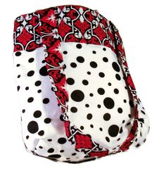 """This market bag is assembled using a polka dot sweater that was headed for the landfill and a black red and white contrasting floral topper.  The bag is 15"""" in height and 16"""" wide.  The double straps are 34 inches long.  The bag is fully lined with red lining.  It is double interfaced to stand on it's own. 