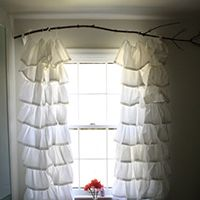 Hang curtains from a branch - and LOTS of other creative, inexpensive curtain rod ideas!