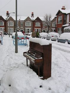 Strange, sad abandoned piano in the snow by daveo