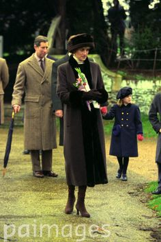 Diana, Princess of Wales followed by her husband, Charles Prince of Wales, arrives at church on the Queen Sandringham estate for the Christmas holiday gathering.  Date: 25 Dec 1994