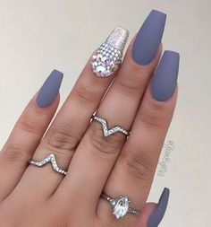 Another proof that glitter gel and rhinestones in combination with matte color on the other nails is great choice.