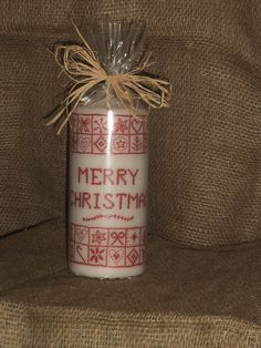 Cross Stitch effect decoupaged candle, wrapped for gifting