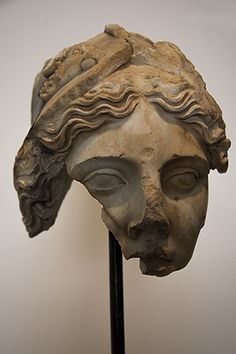 "Aspasia  Described as ""Athena in classical style of fifth century BC,"" but sculpted in the first or second century AD, this bust, which is in the Archaeological Museum at Aphrodisias (Turkey), would seem to have the characteristics of Aphrodite Sosandra. In fact, the hair is parted differently and what seems to be a veil presumably is the fragment of a helmet."