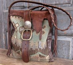 SOLD Leather trim, bridle rein shoulder strap, vintage sterling silver brooches and vintage longhorn bridle concho. All hand stitched.