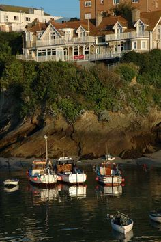Boats in Newquay Harbour with the Terrace Bar and Cafe on the cliff behind Seaside Village, Newquay, Truro, Over The River, Weekend Trips, Cliff, Beautiful Beaches, Cornwall, Terrace