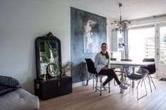 """Our own home on Apartment Therapy ----------- Rowena is an advocate for mixing things up: """"Trust your instincts. When in doubt, just do it!"""" Her interior features quite a few vintage finds, like the antique mirror and the black chest."""