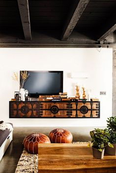 Console table with TV and styled mantle