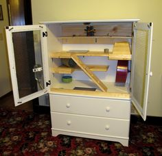 DIY Pet Cage; A cage fashioned from a secondhand armoire. This is perfect to house a child's pet...large doors make cleaning easy.