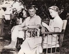 Grace Kelly between takes on the Mogambo set with Clark Gable