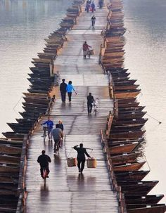 Wooden Boats Bridge, China - Explore the World, one Country at a Time. http://TravelNerdNici.com