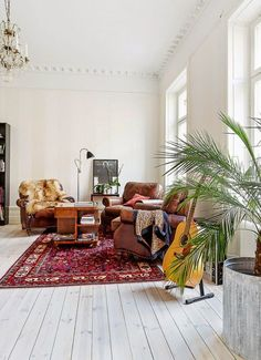Comfortable vintage leather chairs and a lovely persian rug