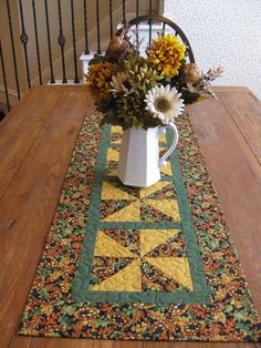 Taking a photograph of a table runner use centerpiece on table.