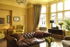 Lovely Warm Living Room Interior with Soft-Blue Sofas & Natural . Lovely Warm Living Room Warm Living Room Colors For Warm Effect New H. Yellow Walls Living Room, Living Room Color Schemes, Paint Colors For Living Room, Living Room Designs, Yellow Bedrooms, Simple Living Room, Elegant Living Room, Beautiful Living Rooms, Small Living Rooms