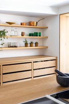 The simplicity of unpainted wood feels both timeless and fresh – and is a style update that has us in a whorl. See how it's done in this kitchen project. Kitchen Dresser, Black Kitchen Cabinets, Black Kitchens, Home Kitchens, Timber Kitchen, New Kitchen, Kitchen Interior, Kitchen Design, Polished Concrete Flooring