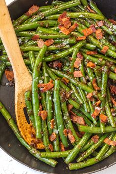 These SKILLET BOURBON BACON GREEN BEANS add some spice, flair, and beauty to any holiday table! The ultimate Thanksgiving side dish SO full of flavor, you'll be blown away!