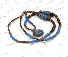 Hippie necklace, handmade brown and blue long necklace, seahorse pendant, beach accessories by Omanie on Etsy https://www.etsy.com/listing/489268106/hippie-necklace-handmade-brown-and-blue