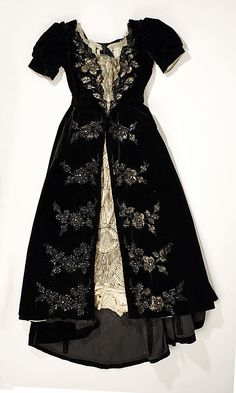 Dress, Evening.  House of Worth(French, 1858–1956).  Date: ca. 1897. Culture: French. Medium: silk, glass, metallic, bone. Dimensions: (a) Length at CB: 16 in. (40.6 cm). (b) Length at CB: 58 in. (147.3 cm).