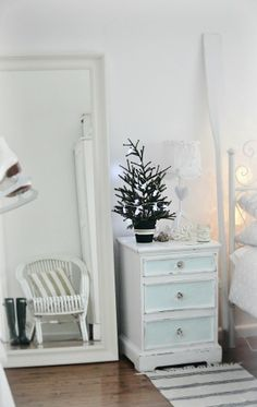 coastal white Christmas bedroom...like the small chest of drawers!