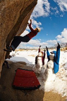 Lydia Zamarano finds a bit of dry rock to climb as well as some local spotters during a freak winter snowstorm in Joshua Tree, California. Photo by Ben Moon