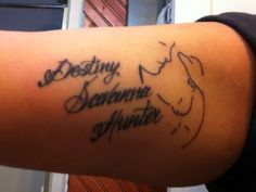 Silhouette of a mother holding one of her babies. My children's name tattooed alongside of the silhouette.