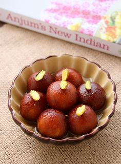 Gulab Jamun.  translation = freakishly delicious donut-ish balls soaked in sweet flavored syrup... for the love of all mankind - try these!!