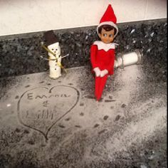 Our Elf on the shelf built a marshmallow snowman and wrote the girls's names in salt snow ;)