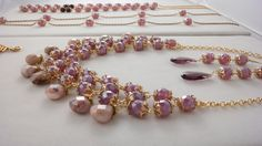 Stunning glass amethyst beaded necklace and earrings.