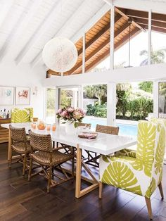 beamed ceilings and louvered jalousie windows add tropical charm