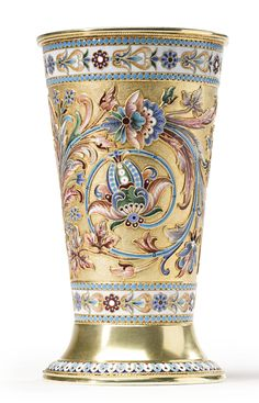 A large Russian gilded silver and shaded enamel beaker, Moscow, retailed by Iosif Marshak, circa 1895, the large stopa-form beaker with brightly colored floral ornament on a stippled gilt ground between polychrome foliate bands on a white ground within turquoise bead borders, a polished cartouche engraved with initials.