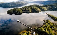 Completed in 2014 in Lake Saint Clair, Australia. Images by Sharyn Cairns, Adam Gibson, Stuart Gibson. Located just inside the Tasmanian Wilderness World Heritage Area, Pumphouse Point was originally constructed as part of Tasmania's hydro electric. Hotel No Lago, Lake Hotel, Cairns, Boutique Hotels, A Boutique, Sainte Claire, St Claire, Nature Sauvage, Reserva Natural