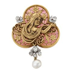 Art Nouveau Plique-a-Jour Pearl Diamond Gold Brooch. A French Art Nouveau 18 karat gold brooch with pearl and plique-a-jour enamel and diamonds. The brooch has a freshwater pearl, and is of plique-a-jour enamel, and decorated with old mine cut and rose cut diamonds weighing approximately .25 carat. The gold relief is that of a young maiden with long hair in three quarter profile.
