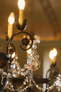 Add some glitzy glamor to your chandelier with sparkling crystals. Transforming your current chandelier into a shimmering focal point is an easy project you can take pride in doing. Ignite your inner . Antique Chandelier, Black Chandelier, Chandelier Lighting, Chandelier Crystals, Painted Chandelier, Crystal Chandeliers, Chandelier Ideas, Outdoor Chandelier, Chandelier Cake Stand