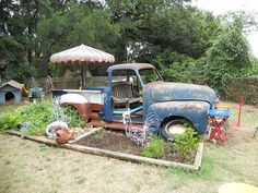 """1953 Chevy truck is now my grand kids """"playscape"""" Some days it is a pirate ship others it is a garbage truck. Sometimes we just sit on the bench in the cab and go to the beach. Our Bar-B-Que pit is under the hood. Wooden step up into the back bed. We love it."""