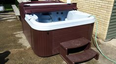 Here is a Nordic Spa delivered by Master Spas of Northern WI and is placed on a concrete patio.