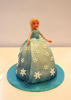Frozen Elsa - three cakes stacked to get the dress, covered and decorated by my sugar paste