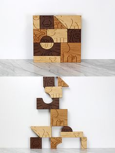 """Aminal"" by Studio Dunn is a puzzle set of 12 wooden animals. Made from scraps of maple, cherry, and walnut, these building blocks are great toys and decorative objects as well."