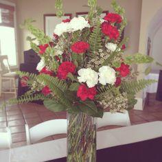 Red Carnations, White Carnations, Red Spray Roses, White Wax Flower, Sword Fern