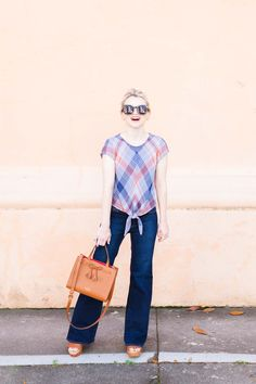 Plaid Tie Front Blouse - Spring Styling - Poor Little It Girl. Blue and red plaid tie front blouse+flare jeans+cognac wedges+cognac handbag+sunglasses. Summer Casual Outfit 2017